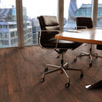 CXGKH4 An executive office with chairs table and view over the city of London